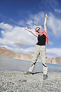 Young European tourist on the shores of Pangong Tso (Pangong lake), India, Jammu and Kashmir, Ladakh