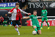 Woking forward Jake Hyde (9) challenges Watford midfielder Tom Cleverley (8) during the The FA Cup 3rd round match between Woking and Watford at the Kingfield Stadium, Woking, United Kingdom on 6 January 2019.