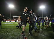 Richie McCaw of the All Blacks walks off with scrum coach Mike Cron after the third rugby test between the All Blacks and England played at Waikato Stadium in Hamilton during the Steinlager Series - All Blacks v England, Hamiton, 21 June 2014<br /> www.photosport.co.nz