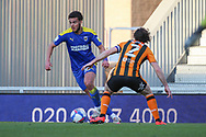 AFC Wimbledon defender Nesta Guinness-Walker (18) battles for possession with Hull City defender Lewis Coyle (2) during the EFL Sky Bet League 1 match between AFC Wimbledon and Hull City at Plough Lane, London, United Kingdom on 27 February 2021.