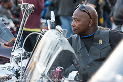 Checking ot the action on Dr. Mary McLeod Bethune Boulevard for what has come to be known as Black Bike Week during Daytona Bike Week. Daytona Beach, FL. USA. Thursday March 16, 2017. Photography ©2017 Michael Lichter.