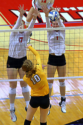 23 November 2017:  Sydney Holt and Allie Line block an attack by Allison Ketcham during a college women's volleyball match between the Valparaiso Crusaders and the Illinois State Redbirds in the Missouri Valley Conference Tournament at Redbird Arena in Normal IL (Photo by Alan Look)