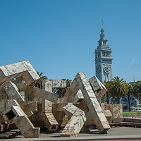 A clocktower at the Embarcadero's Pier One towers above Vaillancourt Fountain and Justin Herman Plaza near downtown San Francisco, California. (The fountain is dry due to drought in 2014.)