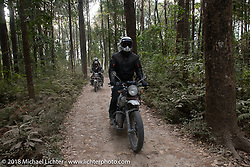 Denver Joe Hicks riding out through the forest from the Kusma Gyadi Bridge on Day-7 of our Himalayan Heroes adventure riding from Tatopani to Pokhara, Nepal. Monday, November 12, 2018. Photography ©2018 Michael Lichter.