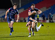Sale Sharks centre Sam Hill is tackled short of the line  during a Gallagher Premiership Round 11 Rugby Union match, Friday, Feb 26, 2021, in Eccles, United Kingdom. (Steve Flynn/Image of Sport)
