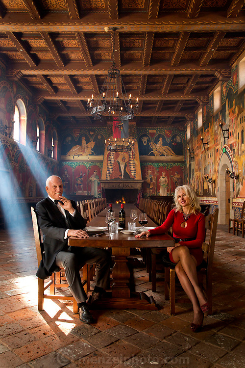 Dario Sattui and Irina in the Great Hall of Castello di Amorosa Winery, Napa Valley, California. Fire added digitally from an earlier frame of same situation.