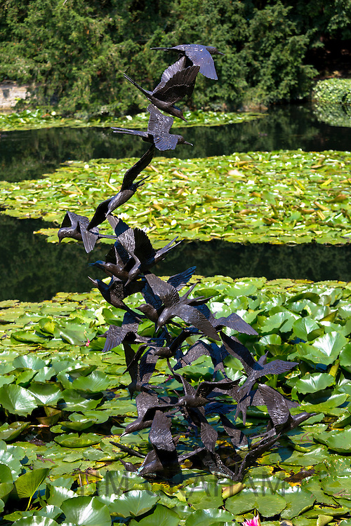 Sculpture of a flock of 29 terns in bronze by Lloyd Le Blanc above the lake at Le Manoir Aux Quat' Saisons in Oxfordshire, UK