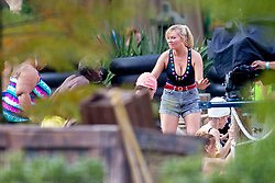 """EXCLUSIVE: Kirsten Dunst was spotted showing off her toned body while filming a pool scene for her AMC tv series """"On Becoming a God in Central Florida"""". Kirsten wore a bejewelled black swimsuit with high rise denim shorts, accessorising with hooped gold earrings and her hair tied back in a ponytail. She could be seen filming scenes with fellow actor Kevin J. O'Connor while a group of swimmers all run out past the two. The series, filming in Louisiana, is about """"Krystal Gill"""" (Dunst's character), a minimum-wage-earning water park employee who will eventually scheme her way up the ranks of Founders American Merchandise: the cultish, flag waving, multi-billion dollar pyramid scheme that drove her family to ruin. 19 Nov 2018 Pictured: Kirsten Dunst. Photo credit: MEGA TheMegaAgency.com +1 888 505 6342"""