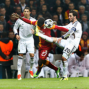Galatasaray's Emmanuel Eboue (C) and Real Madrid's Gonzalo Higuain (R) during their UEFA Champions League Quarter-finals, Second leg match Galatasaray between Real Madrid at the TT Arena AliSamiYen Spor Kompleksi in Istanbul, Turkey on Tuesday 09 April 2013. Photo by Aykut AKICI/TURKPIX