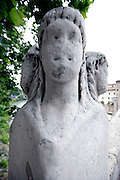 combination of mutilation and weathered bridge sculpture in Rome Italy