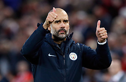 Manchester City manager Pep Guardiola acknowledges the fans after the Premier League match at Anfield, Liverpool.