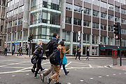 The day after Facebook's Mark Zuckerberg faced Senate Committee questions in Washington, a family crosses the road outside the offices of Cambridge Analytica on New Oxford Street, the UK tech company accused of harvesting the personal details of Facebook users (including Zuckerberg himself) in its data privacy scandal, on 11th April, 2018, in London, England.