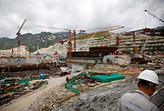 A worker walks near Unit 1 that is still under construction at the Taishan Nuclear Power Plant project in Taishan, Guangdong Province, China, on July 29, 2010. Despite concerns toward the safety of nuclear power as demonstrated by Japan's Fukashima disaster, China is forging ahead with its plans of rapidly expanding its nuclear power generation capacity.