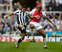 Fotball<br /> Photo. Jed Wee, Digitalsport<br /> NORWAY ONLY<br /> Newcastle United v Arsenal, FA Barclaycard Premiership, St James' Park, Newcastle. 11/04/2004.<br /> Newcastle's Jermaine Jenas (L) scraps for possession with Arsenal's Patrick Viera.