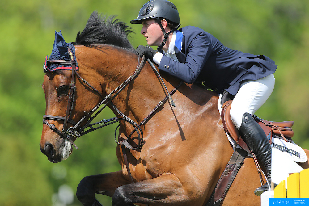 Michael Hughes riding Macarthur in action during the $100,000 Empire State Grand Prix presented by the Kincade Group during the Old Salem Farm Spring Horse Show, North Salem, New York,  USA. 17th May 2015. Photo Tim Clayton