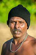 A fisherman posing on Matara beach, Sri Lanka