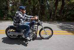 "Eric Stein of Indian Trail, NC riding a Bill Dodge ""Blings Cycles"" custom Harley-Davidson Shovelhead through Tamoka State Park during Daytona Beach Bike Week 2015. FL, USA. Friday, March 13, 2015.  Photography ©2015 Michael Lichter."