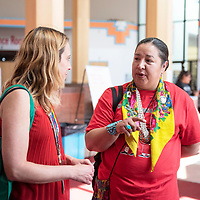 Navajo Nation Council Delegate Amber Kanazbah Crotty, right, speaks with Rebecca Willis, left, a midwife at Tsehootsooi Medical Center and a sexual assault examiner with Family Advocacy Center at an awareness event for Missing and Murdered Indigenous Women, Thursday, May 30 at the Navajo Nation Museum in Window Rock.