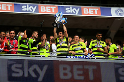Huddersfield Town's Dean Whitehead lifts the trophy