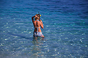 Model Released Young girl snorkelling blue clear sea water, Sicily, Italy