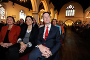 Leader of the British Liberal Democrat Party Nick Clegg (R) sits with his wife Miriam Gaonzalez Durantez in a church in South West London during the British Election Campaign.