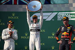 MELBOURNE, March 17, 2019  First-placed Mercedes driver Valtteri Bottas of Finland (C) celebrates with his trophy beside second-placed Mercedes driver Lewis Hamilton (L) of Britain and third-placed Red Bull driver Max Verstappen of the Netherlands during the awarding ceremony of Formula 1 Australian Grand Prix 2019 at the Albert Park in Melbourne, Australia, March 17, 2019. (Credit Image: © Bai Xuefei/Xinhua via ZUMA Wire)