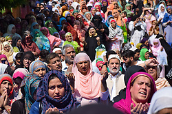 May 27, 2019 - Srinagar, Jammu and Kashmir, India - Kashmiri Muslim devotees are seen raising their hands to seek for blessings as a head priest (Not In Photograph) displays a relic believed to be hair from beard of Prophet Muhammad PBUH at the Hazratbal shrine to mark the Martyr Day of Hazrat Ali PBUH during the holy month of Ramadan in Srinagar..Muslims across the world refrain from eating, drinking and smoking from dawn to dusk to observe the holy fasting month of Ramadan. (Credit Image: © Idrees Abbas/SOPA Images via ZUMA Wire)
