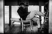 James Brown relaxes on the porch of the Seashore Farmers' Lodge in the Sol Legare Gullah community on James Island.
