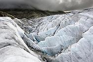 Crevasses, rocks and clouds at the glacier Grosser Aletschgletscher, Valais, Switzerland