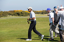 Former US president Barack Obama playing golf at St Andrews. With his Iced Tea.