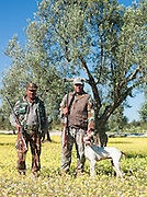 Hunter with thier dog at a Olive Grove outside Mahdia, Tunisia