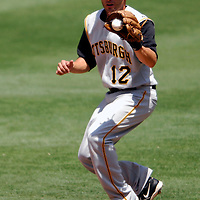 01 June 2007:  Pittsburgh Pirates second baseman Freddy Sanchez (12) jumps in the air in the 6th inning to field a ground ball hit by Washington Nationals first baseman Dmitri Young.  The Pirates defeated the Nationals 3-2 at RFK Stadium in Washington, D.C.  ****For Editorial Use Only****