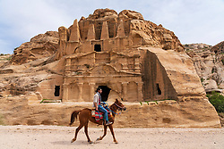 A horse walks past the Obelisk Tomb in Petra, Jordan. Work heritage site