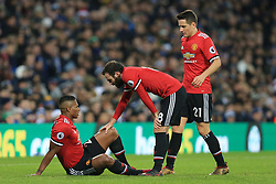 17th December 2017 - Premier League - West Bromwich Albion v Manchester United - Luis Antonio Valencia of Man Utd (L) is tended to by teammates Juan Mata (C) and Ander Herrera (R) after sustaining an injury - Photo: Simon Stacpoole / Offside.