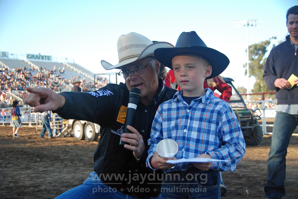 """Jack Nolan, right, winner of the """"Mutton Bustin"""" trophy, gets some help finding the TV cameras at the 102nd California Rodeo Salinas, which opened July 19 for a four-day run."""