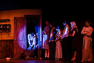 """Goshen, New York - Members of the Goshen High School Drama Club peform on stage during a dress rehearsal of """"Register Here"""" in the auditorium on Nov. 5, 2015. The play is a murder-mystery farce by David Meyer."""