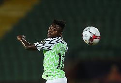 July 17, 2019 - Cairo, Tunisia, Egypt - FRANCE OUT July 17, 2019: Moses Daddy Simon of Nigeria heading the ball during the 2019 African Cup of Nations match between Tunisia and Nigeria at the Al Salam Stadium in Cairo, Egypt.  (Credit Image: RealTime Images)