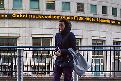 A worker passes the ticker at Canary Wharf telling hier FTSE 100 stocks have plummeted to a 13 month low as European markets follow US and Asian markets lower on Tuesday as investors continued to dump shares. London, February 06 2018.