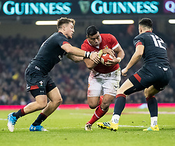 Siale Piutau of Tonga under pressure from Tyler Morgan of Wales<br /> <br /> Photographer Simon King/Replay Images<br /> <br /> Under Armour Series - Wales v Tonga - Saturday 17th November 2018 - Principality Stadium - Cardiff<br /> <br /> World Copyright © Replay Images . All rights reserved. info@replayimages.co.uk - http://replayimages.co.uk