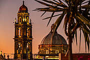 Colorful sunset over the bell tower and dome of the San Francisco church in the historic city center of San Miguel de Allende, Mexico.