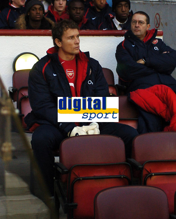 Photo: Javier Garcia/Back Page Images<br />Arsenal v Birmingham FA Barclays Premiership Highbury 04/12/04<br />Jens Lehmann looks forlornly on from the subs' bench
