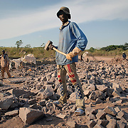 """A worker in a quarry near Brazzaville, Congo, 2007.<br /> <br /> Allthough the main quarry was operated by a  multinational corporation with the most modern technology, there is room for local interests to pursue exploration with more """"traditional"""" methods."""