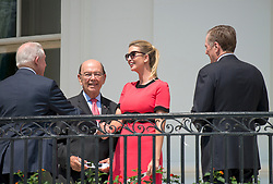 Ivanka Trump, right center, shakes hands with United States Attorney General Jeff Sessions, left, as US Secretary of Commerce Wilbur Ross, left center, and US Trade Representative Robert E. Lighthizer, right, prepare to look at the partial eclipse of the sun from the Blue Room Balcony of the White House in Washington, DC on Monday, August 21, 2017.<br /> Credit: Ron Sachs / CNP