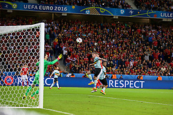 LILLE, FRANCE - Friday, July 1, 2016: Wales' Sam Vokes scores the third goal against Belgium, to make the score 3-1, during the UEFA Euro 2016 Championship Quarter-Final match against Belgium at the Stade Pierre Mauroy. (Pic by Paul Greenwood/Propaganda)