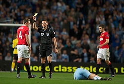 MANCHESTER, ENGLAND - Monday, April 30, 2012: Manchester United's Phil Jones is shown the yellow card during the Premiership match at the City of Manchester Stadium. (Pic by Chris Brunskill/Propaganda)