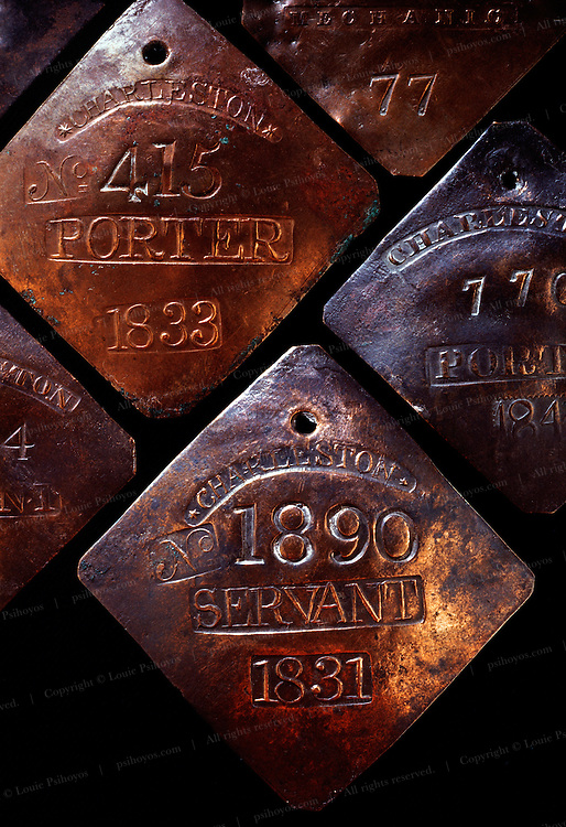 Copper slave tags identified a slave only by number when they were hired out in South Carolina.  Slaves without tags or identification papers were put in jail.