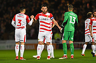 Andrew Butler of Doncaster Rovers (6) shakes team mates' hands before kick off during the EFL Sky Bet League 1 match between Doncaster Rovers and Sunderland at the Keepmoat Stadium, Doncaster, England on 23 October 2018.