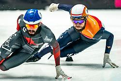 Sjinkie Knegt of Netherlands, Steven Dubois of Canada in action on 500 meter during ISU World Short Track speed skating Championships on March 05, 2021 in Dordrecht