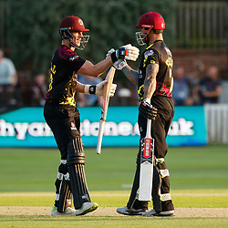 Somerset's Peter Trego celebrates the win with team-mate Tom Abell<br /> <br /> Photographer Simon King/Replay Images<br /> <br /> Vitality Blast T20 - Round 1 - Somerset v Gloucestershire - Friday 6th July 2018 - Cooper Associates County Ground - Taunton<br /> <br /> World Copyright © Replay Images . All rights reserved. info@replayimages.co.uk - http://replayimages.co.uk