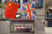 The Chinese and British flags side-by-side on an exhibition stand at the Farnborough Airshow, on 16th July 2018, in Farnborough, England.